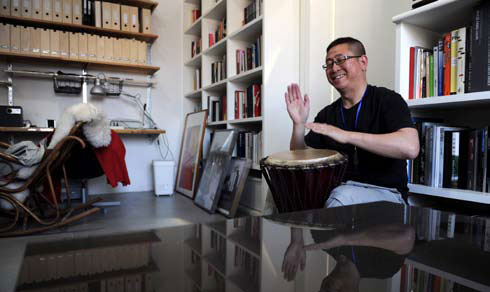 Playing the African drum is one of Zhang's hobbies.