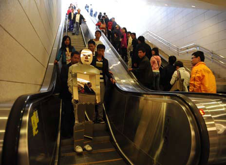 "Zhang brings his ""performance art"" to Beijing's subway."